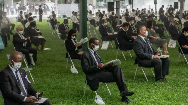 People sit in socially distanced chairs as a precaution against coronavirus as they as they attend the 75th anniversary of the Hiroshima atomic bombing,