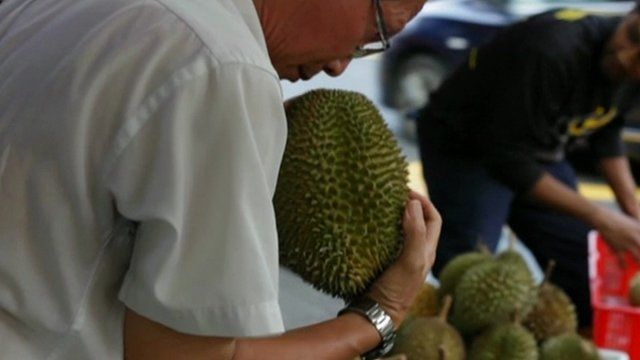 Man holds durian