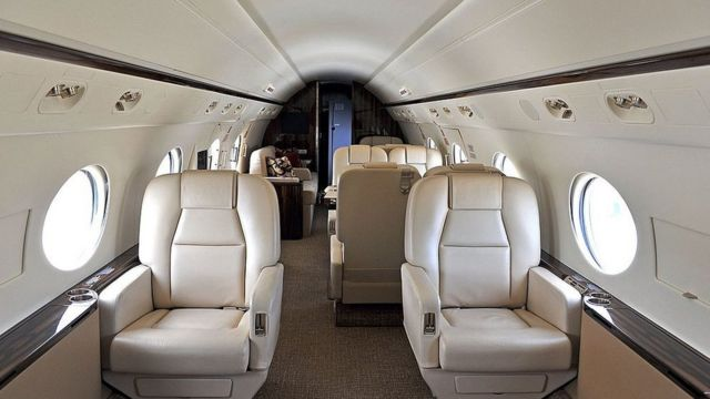 The interior of a private jet.