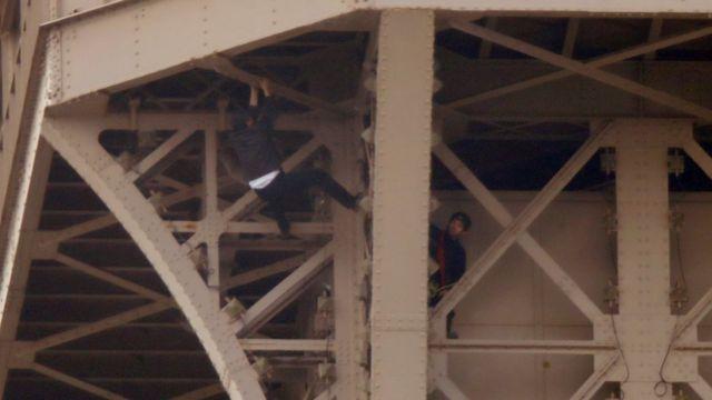Eiffel Tower climber in custody after reaching top