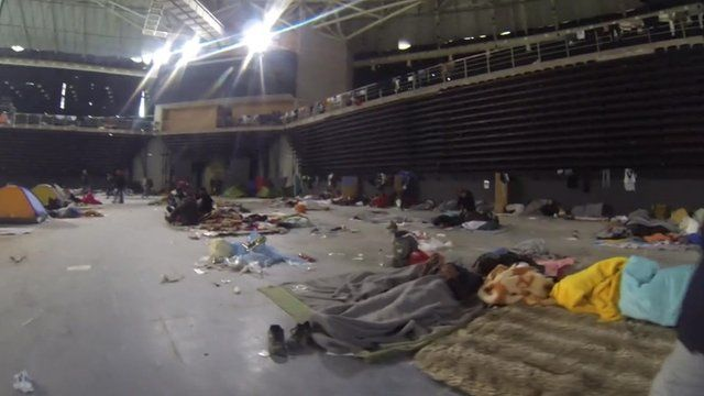 Inside a former Olympic stadium now housing refugees