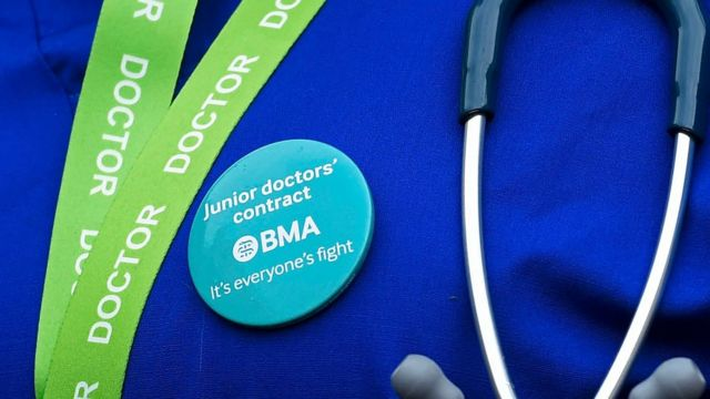 Doctor wearing BMA Junior Doctor's contract badge supporting fight