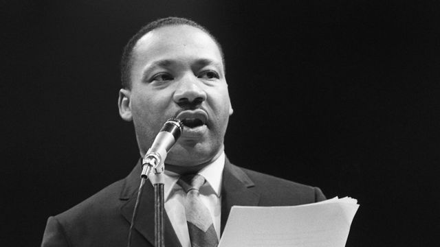 Clergyman and civil rights campaigner Martin Luther King delivering a speech