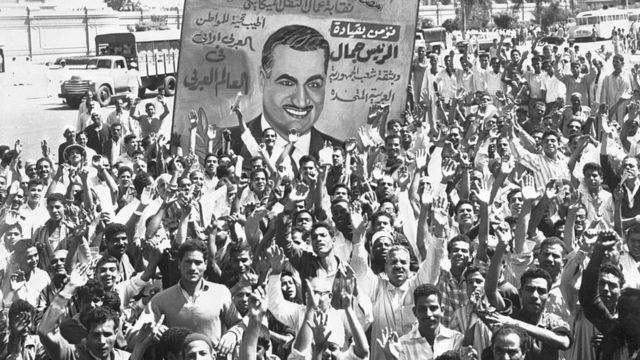 Protesters in Egypt hold up an image of Nasser after the revolt in Syria that led to the dissolution of the United Arab Republic.