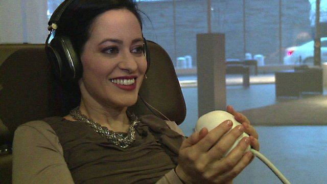 BBC Click's LJ Rich holds an orb that reacts to singing