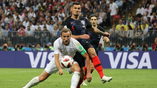 "England""s Harry Kane and Croatia""s Dejan Lovren battle for the ball during the FIFA World Cup, Semi Final match at the Luzhniki Stadium, Moscow"