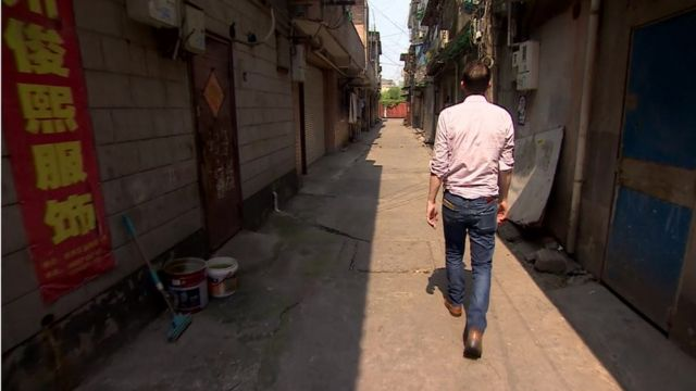 The BBC's John Sudworth in the empty streets of Hangzhou