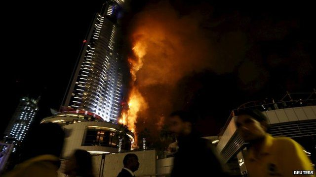 People moving away from hotel on fire