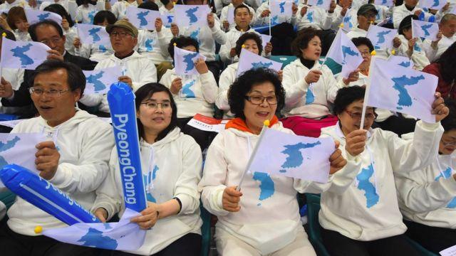 South Korean fans waving unification flags