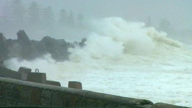 Waves crashing onto coastline