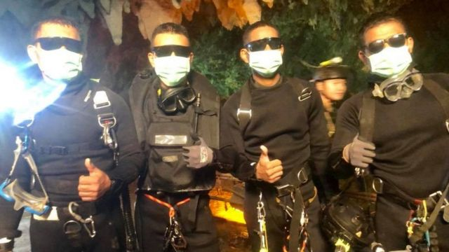 Rescue divers give the thumbs up in the cave July 2018