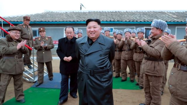 """A state media image said to show Kim Jong-un inspecting the testing of a """"super-large multiple-rocker launcher"""""""