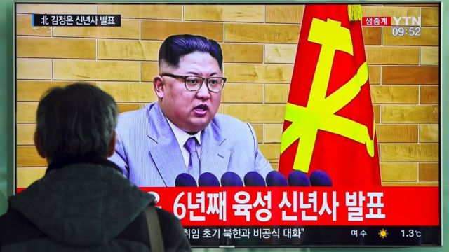 A man watches a broadcast of Kim Jong-un's New Year's speech in Seoul.