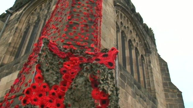 Knitted poppies display on the side of St Mary's Church, Thirsk