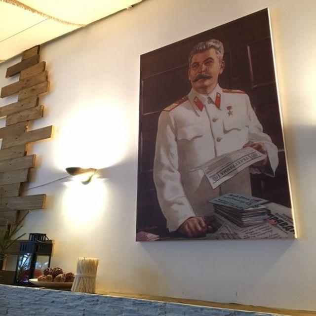 Stalin portrait in restaurant