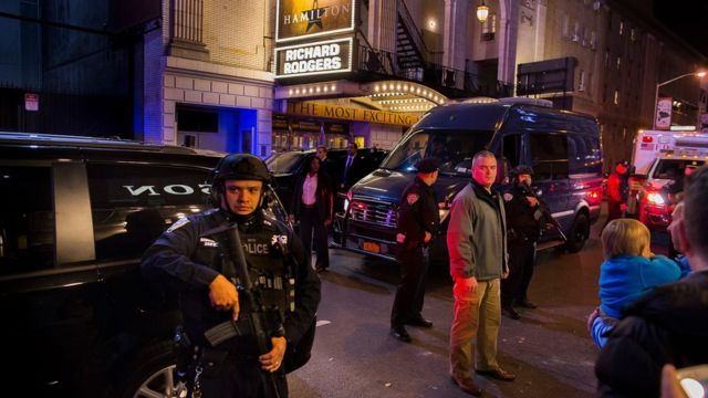 Heavily armed police stand guard as a motorcade carrying Vice President-elect Mike Pence,
