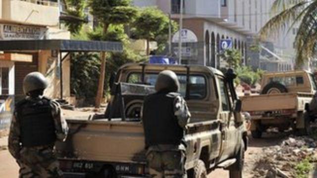 Malian troops outside the Radisson Blu Hotel in Bamako