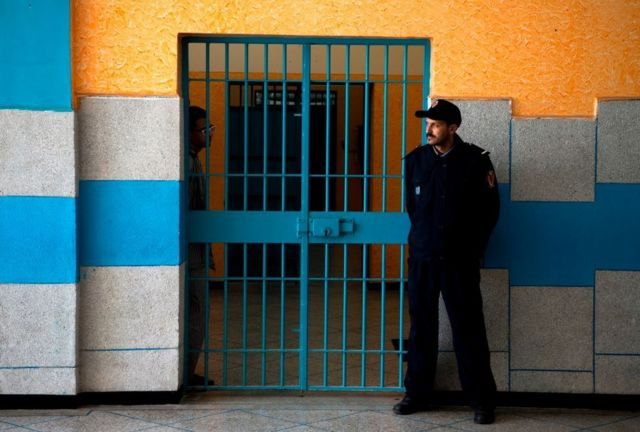 A prison warden stands guard at the Oukacha prison in Casablanca on February 2, 2018.