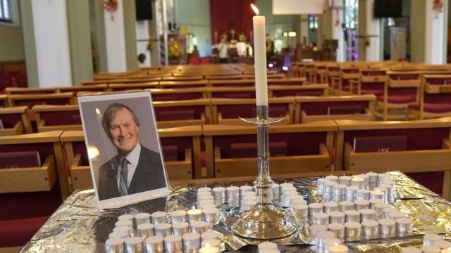 A photo of Sir David Amess at a vigil for him