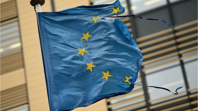 A shredded European Union flag flutters in the wind in Brussels
