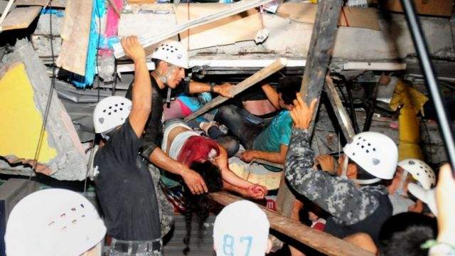 Two survivors are pulled from a collapsed building in the city of Manta, 17 April