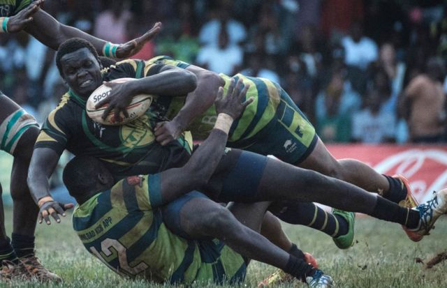 Kabras Sugar's Johnston Mungau (C) is tuckled by Kenya Commercial Bank's Brian Omondi (L) and Peter Kilonzo during the Kenya Cup's final match between Kenya Commercial Bank and Kabras Sugar at the KCB Sports Club in Nairobi, on March 24, 2018