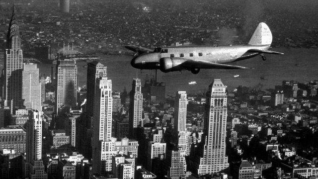 A Boeing Model 247D flies over New York
