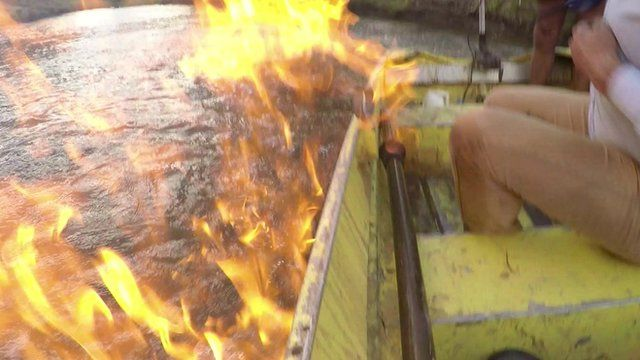 Australian MP Jeremy Buckingham sets the Condamine River in Queensland on fire