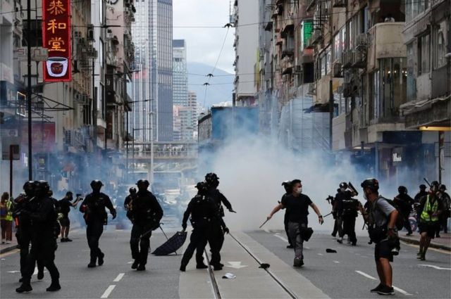 "Riot police fire tear gas into the crowds to disperse anti-national security law protesters during a march at the anniversary of Hong Kong""s handover to China from Britain in Hong Kong, China July 1, 2020."