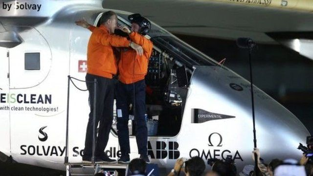 The two pilots embraced on landing