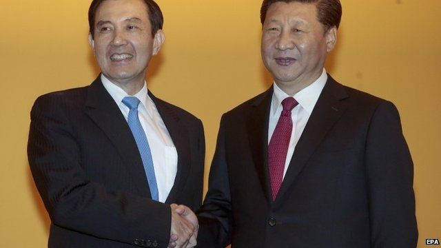 Taiwanese President Ying-jeou (L) and Chinese President Xi Jinping (R) shake hands