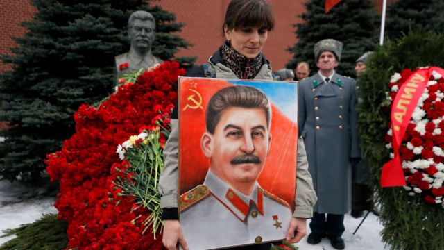 Woman holding Stalin portrait in Red Square, Moscow, 5 Mar 19