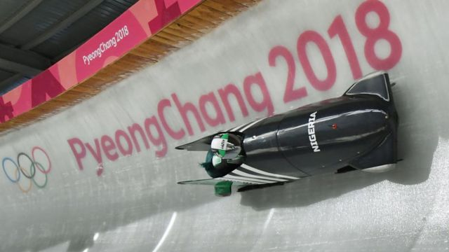 Team leader and driver Seun Adigun of Nigeria take a turn during the first unofficial bobsleigh women training session at the Olympic