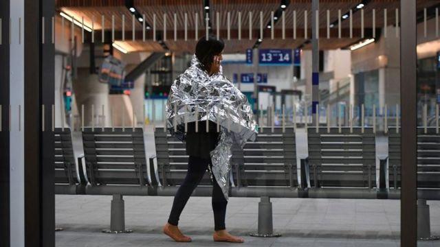 A woman walks through London Bridge after the attack