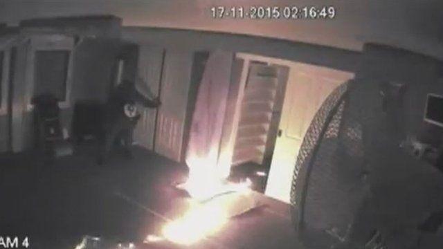 CCTV shows a man setting a mosque alight
