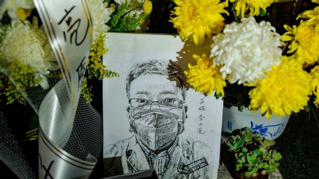 This photo taken on February 7, 2020 shows a photo of the late ophthalmologist Li Wenliang