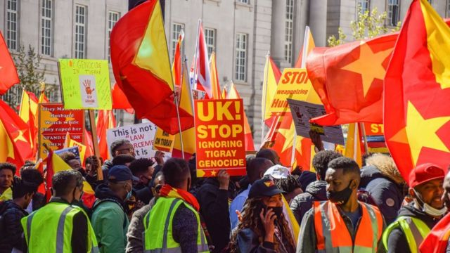 2021/04/25: Protesters gather while holding Tigray flags during the demonstration. Thousands of people marched through Central London in protest of what the demonstrators call Ethiopia's and Eritrea's