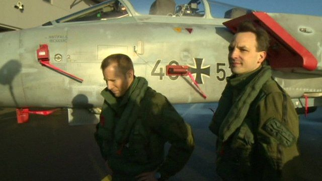 German military pilots in front of German fighter jet