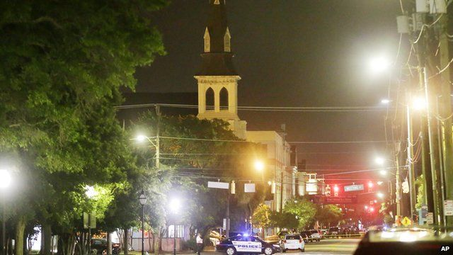 Night shot of the Emanuel African Methodist Episcopal Church in Charleston with police vehicle by the church