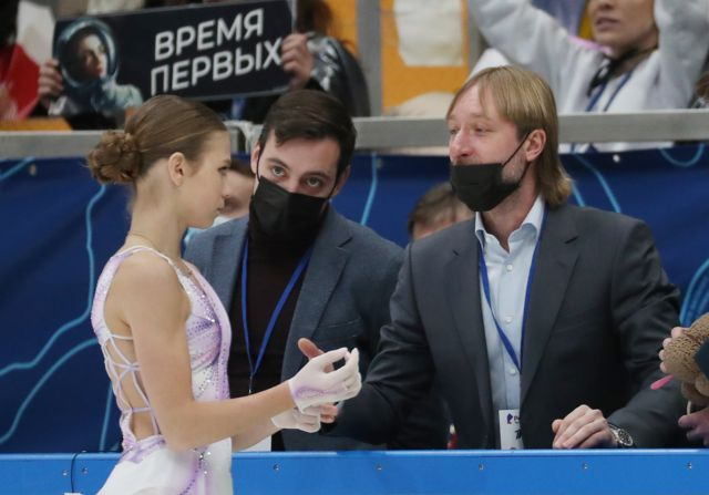 Figure skater Alexandra Trusova (L front) and coach Evgeny Plushenko (R) are seen during the women single's short programme on Day 2 of the Channel One Figure Skating Cup