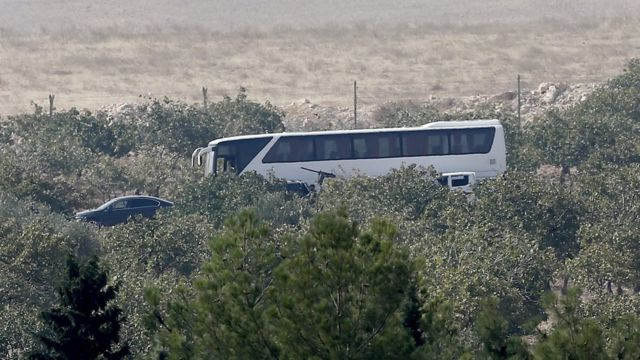 A coach said to be carrying Syrian rebels stands in Karkamis, near Turkey's Syrian border, 24 August