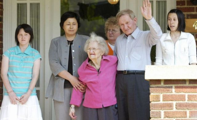 65-year-old Charles Jenkins poses for photos with his mother Pattie Casper, his wife Hitomi Soga, and their daughters Brinda and Mika after his reunion with his 91-year-old mother in Weldon, North Carolina