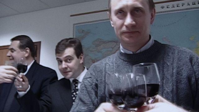 Празднование победы в избирательном штабе Путина. За спиной новоизбранного президента - глава штаба Дмитрий Медведев