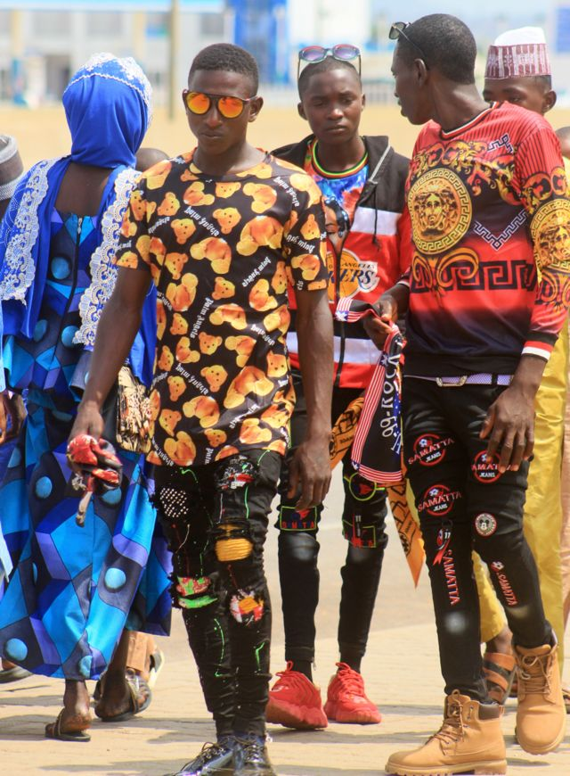 Fulani men in colourful outfits