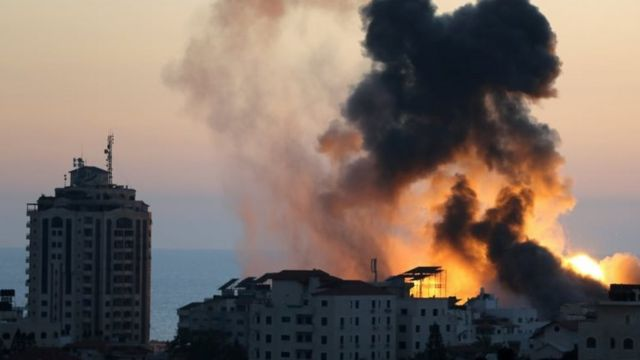 Smoke and flames rise during Israeli air strikes, in Gaza city