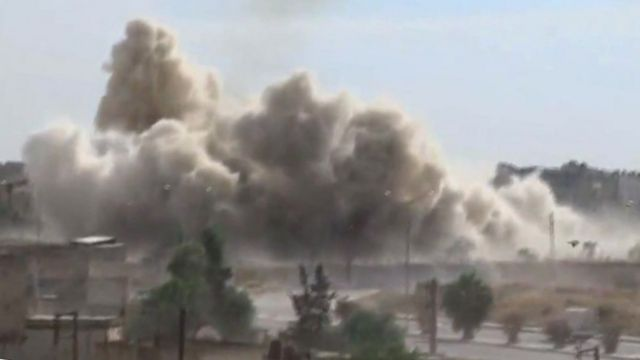 Smoke rises after an airstrike in Aleppo