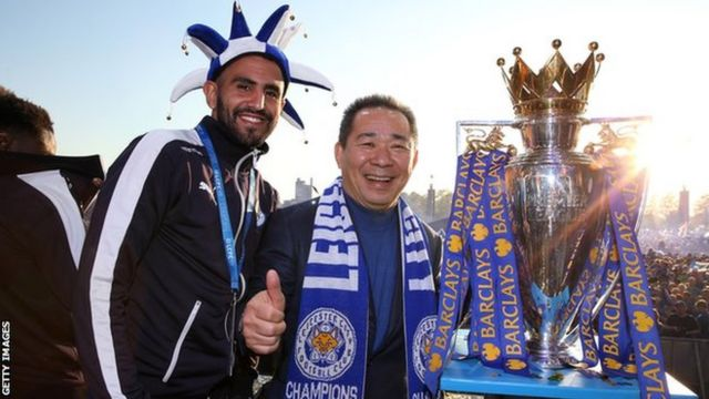 Riyad Mahrez (left) with the late Leicester City owner Vichai Srivaddhanaprabha and the Premier League trophy