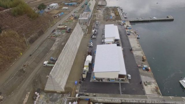 A new sea wall is being built in the waterfront area of Rikuzentakata