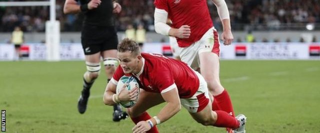 Full-back Hallam Amos' try was Wales' highlight of a lop-sided first half against New Zealand