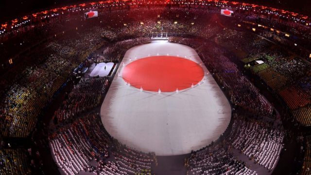 A file photo taken on August 22, 2016 shows an overview of the presentation of Tokyo 2020 during the closing ceremony of the Rio 2016 Olympic Games under the rain at the Maracana stadium in Rio de Janeiro